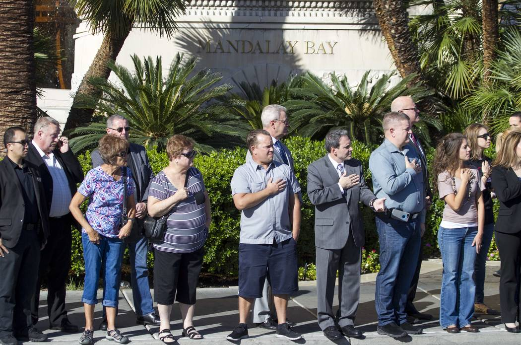 Mandalay Bay employees and passersby pay their respects as the procession for Metro officer Charleston Hartfield drives by the Mandalay Bay en route to a memorial service on Friday, Oct. 20, 2017. ...
