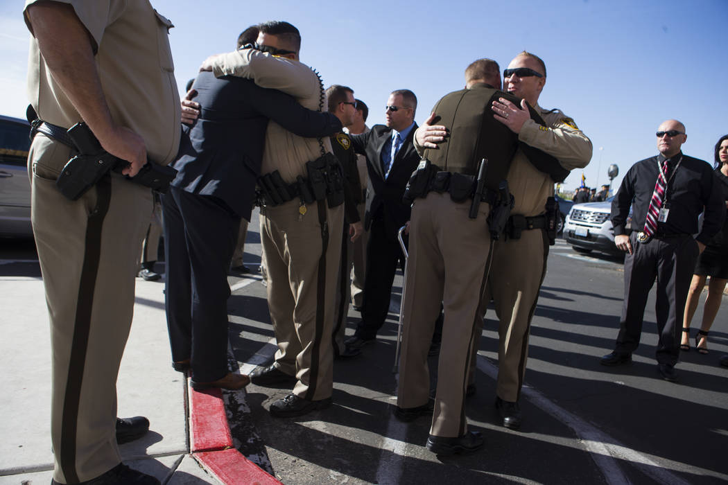Las Vegas police officers embrace before the funeral service for Las Vegas Police Officer Charleston Hartfield at Central Christian Church in Henderson on Friday, Oct. 20, 2017. Hartfield was kill ...