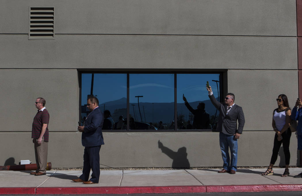 People wait for the motorcade before the funeral service for Las Vegas Police Officer Charleston Hartfield at Central Christian Church in Henderson on Friday, Oct. 20, 2017. Hartfield was killed b ...