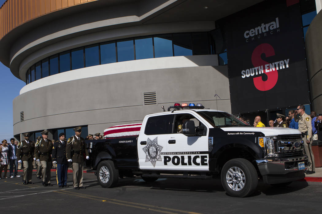 The casket of Las Vegas Police Officer Charleston Hartfield arrives at Central Christian Church before the start of his funeral in Henderson on Friday, Oct. 20, 2017. Hartfield was killed by a gun ...