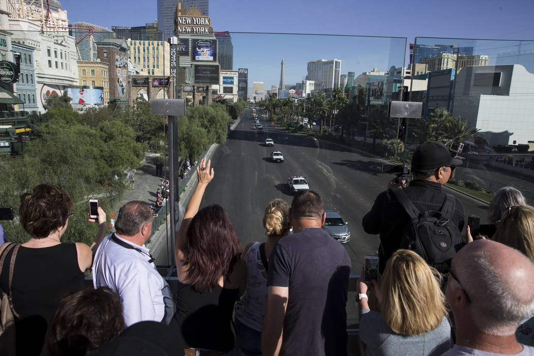 The funeral procession of Las Vegas police officer and Nevada National Guard veteran Charleston Hardfield, at the intersection of Tropicana Ave and Las Vegas Bouelevard in Las Vegas, Friday, Oct.  ...