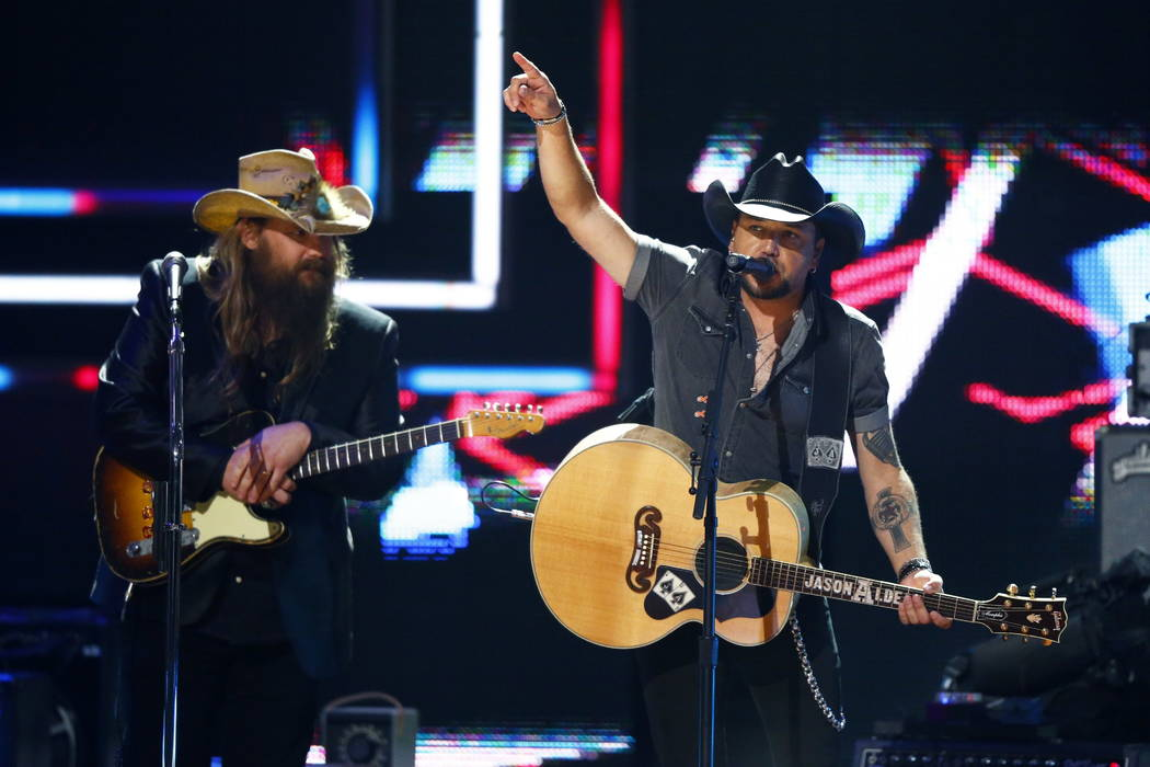 Chris Stapelton, left, and Jason Aldean perform at 2017 CMT Artist of the Year Awards at Nashville's Schermerhorn Symphony Center on Wednesday, Oct. 18, 2017, in Nashville, Tenn. (Photo by Wade Pa ...