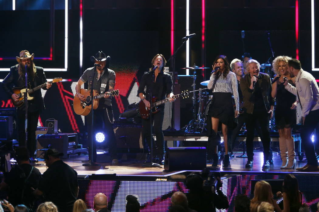 Chris Stapelton, left, Jason Aldean, Keith Urban and Little Big Town perform at 2017 CMT Artist of the Year Awards at Nashville's Schermerhorn Symphony Center on Wednesday, Oct. 18, 2017, in Nashv ...