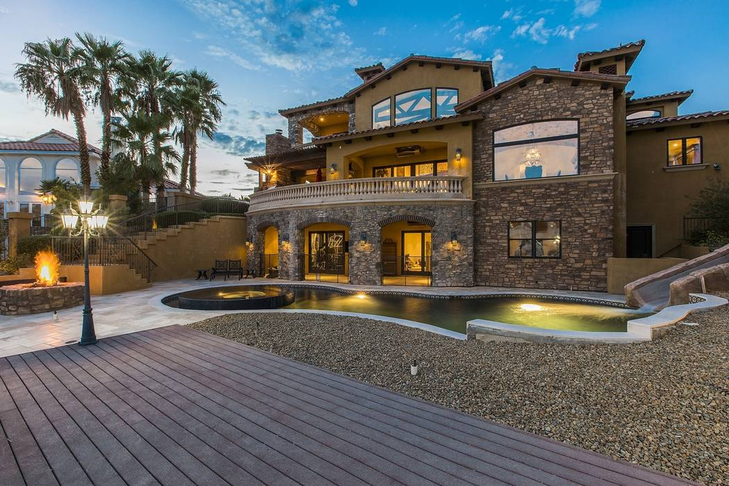 The home has a resort-style pool and water slide near the boat dock. (Team Carver, Berkshire Hathaway Home Services)