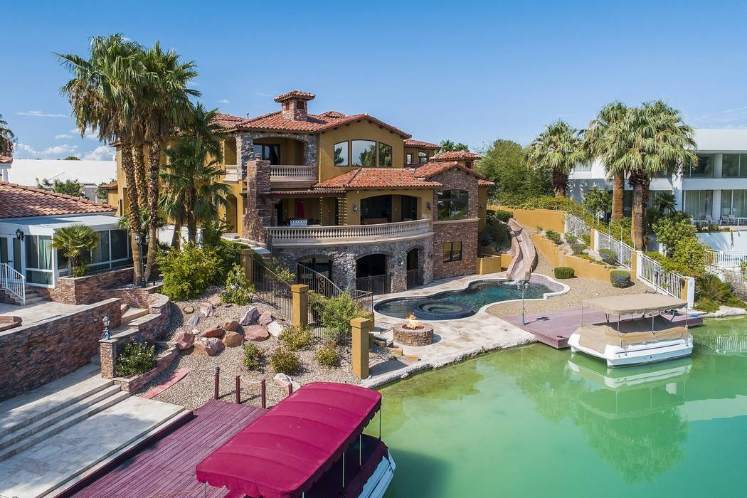 The 9,469-square-foot Lakes Estates home has its own boat dock. (Team Carver, Berkshire Hathaway Home Services)
