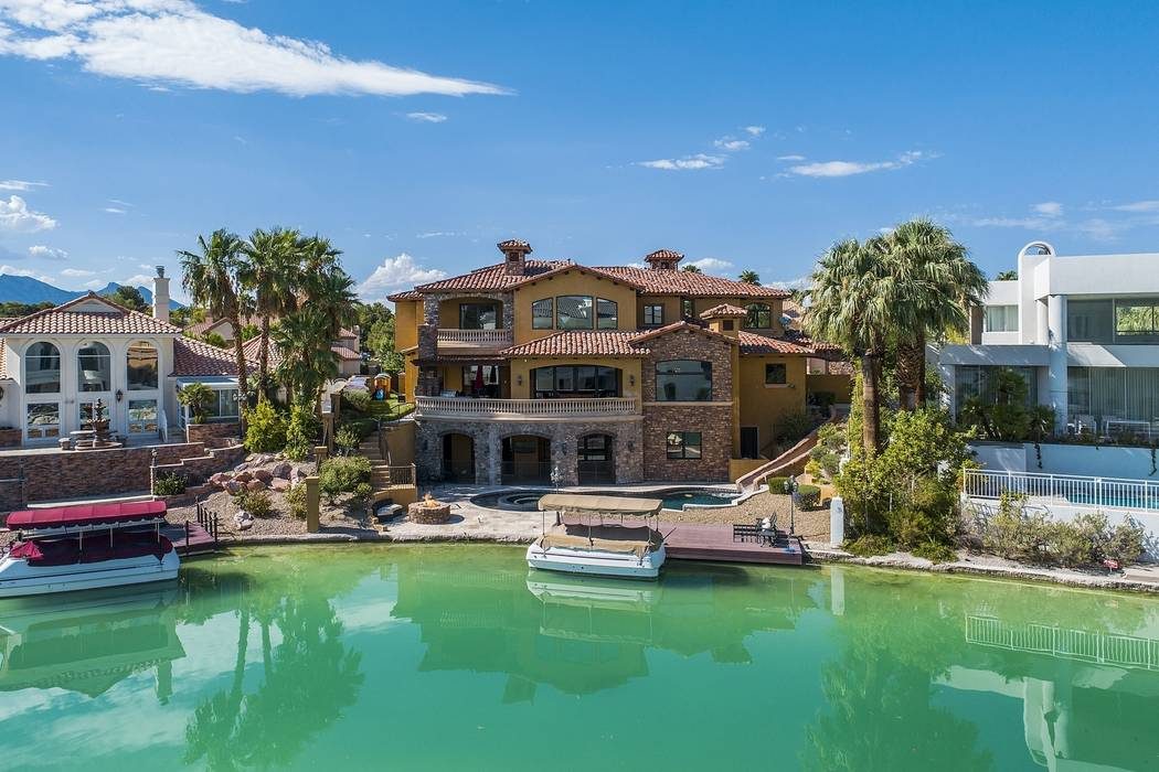 The Lakes Estates home sits on the ommunity's private 30-acre Sahara Lake. (Team Carver, Berkshire Hathaway Home Services)