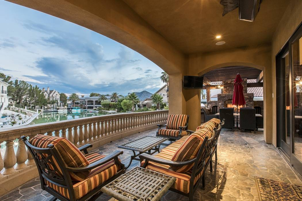 The patio has a view of the lake. (Team Carver, Berkshire Hathaway Home Services)