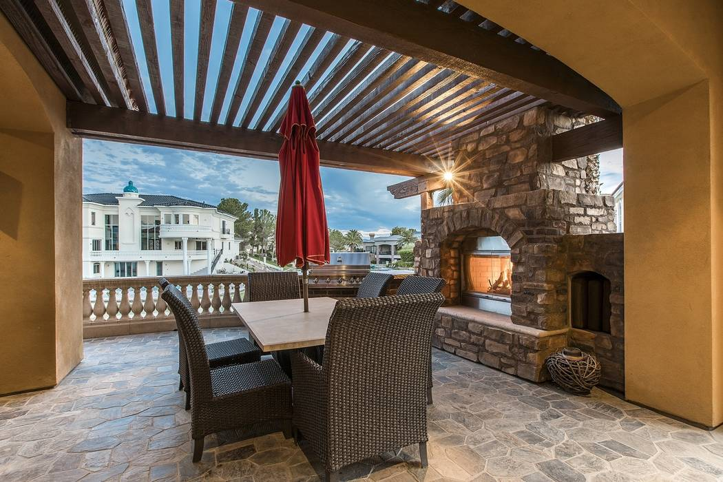 A patio features a gas fireplace. (Team Carver, Berkshire Hathaway Home Services)