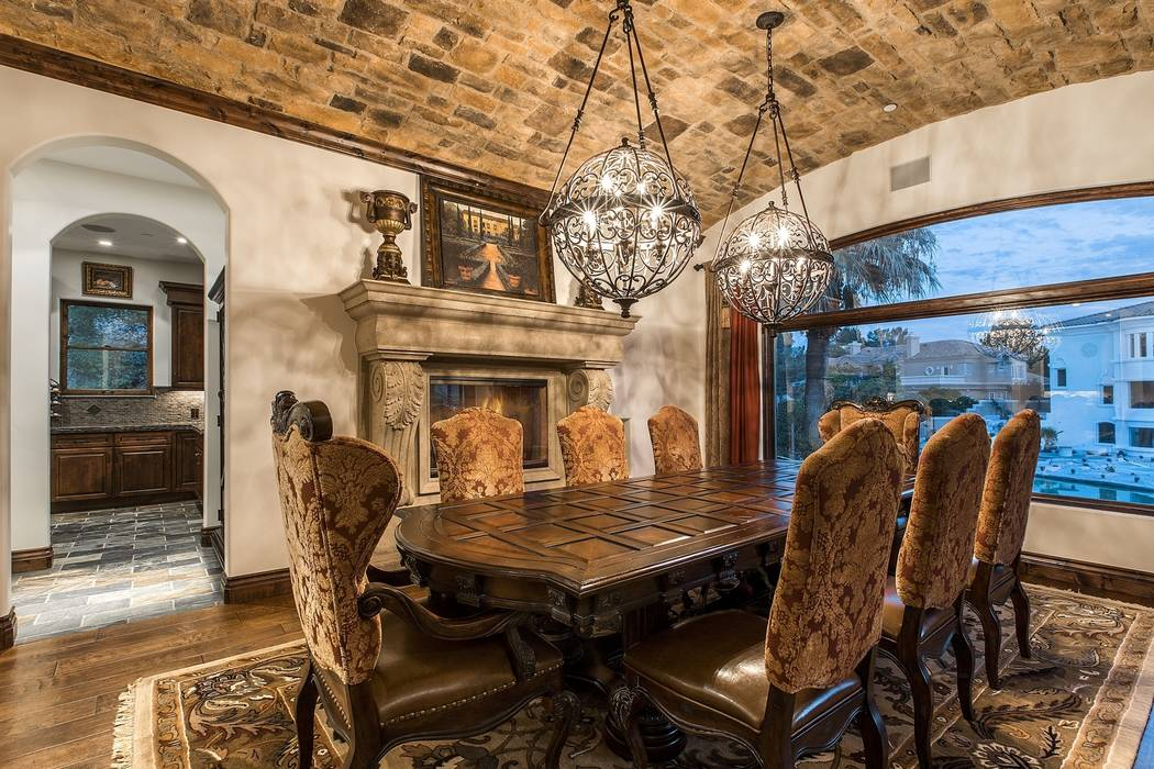 The formal dining room has Old World charm. (Team Carver, Berkshire Hathaway Home Services)