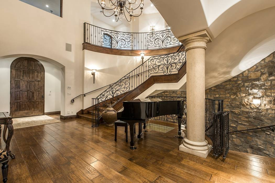 The grand staircase leads guest from the foyer to the upper level. (Team Carver, Berkshire Hathaway Home Services)