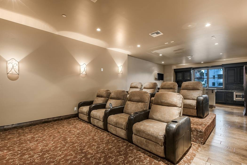 The home theater seats eight. (Team Carver, Berkshire Hathaway Home Services)