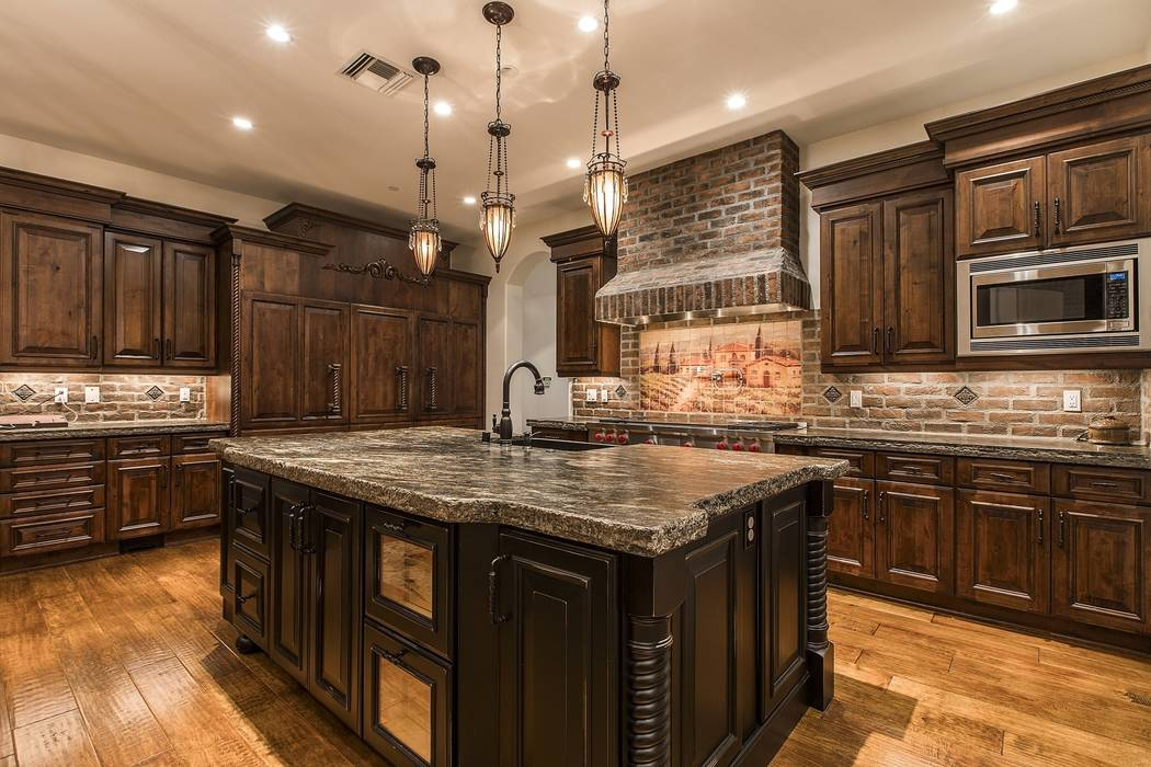 The home's kitchen has an Old World feel. (Team Carver, Berkshire Hathaway Home Services)