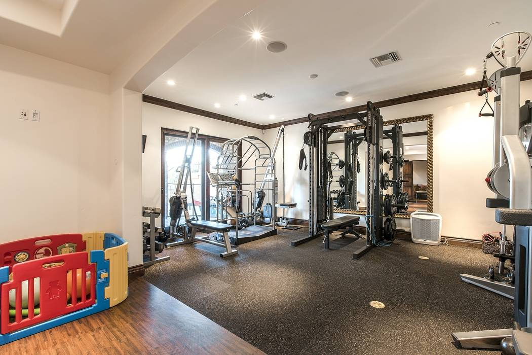The gym is adjacent to the family room. (Team Carver, Berkshire Hathaway Home Services)