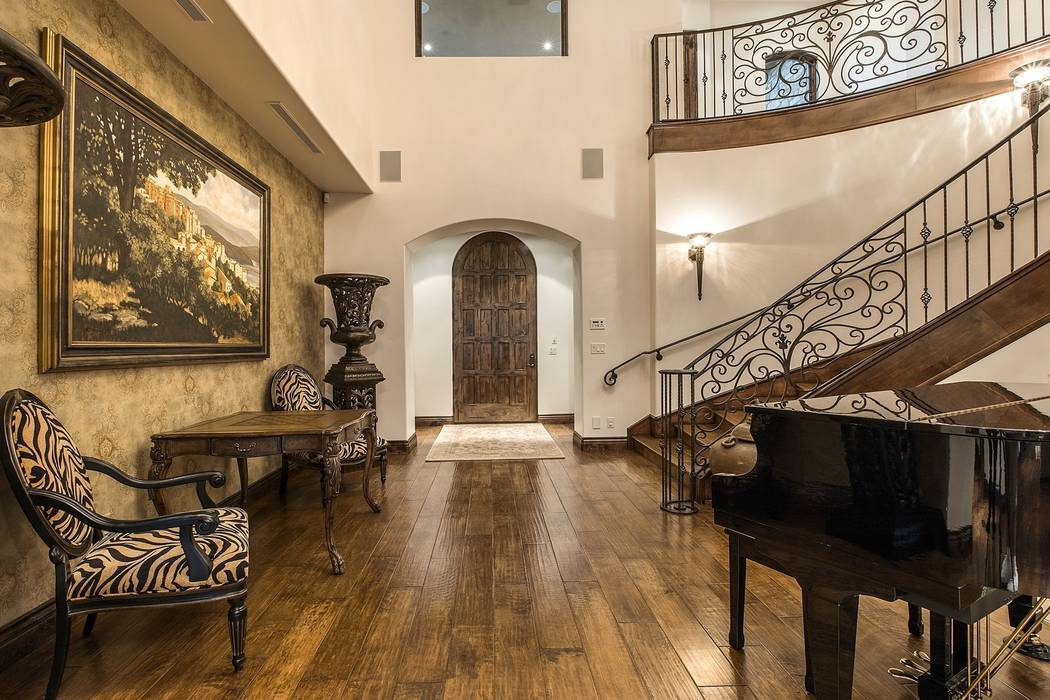 The foyer leads to the upper level. (Team Carver, Berkshire Hathaway Home Services)
