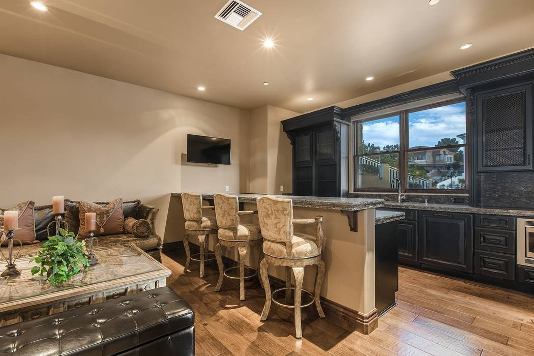 The home theater has a bar. (Team Carver, Berkshire Hathaway Home Services)