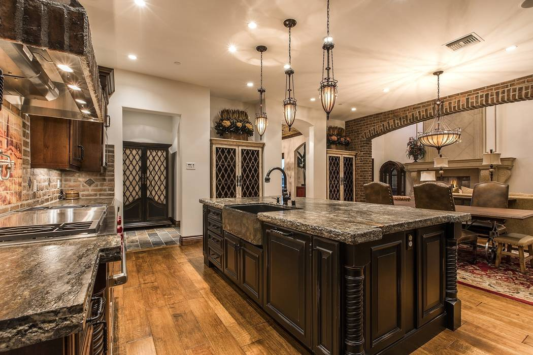 The kitchen has a large central island. (Team Carver, Berkshire Hathaway Home Services)