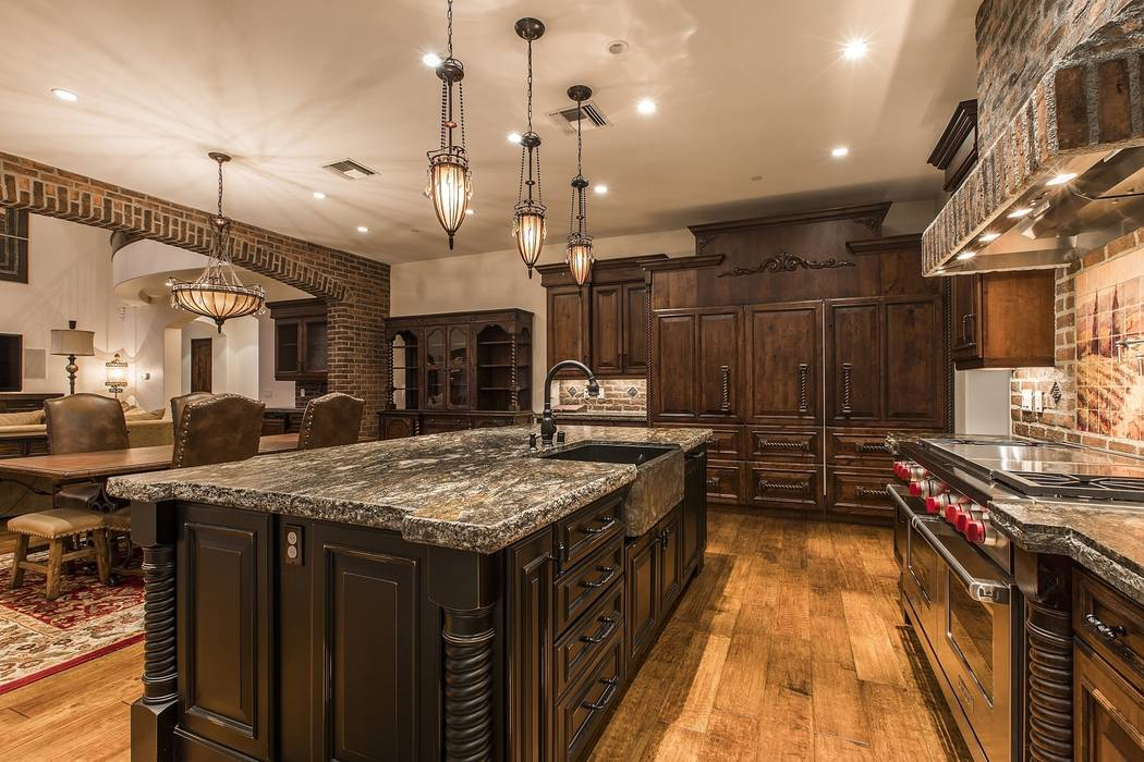 The kitchen has upgraded appliances. (Team Carver, Berkshire Hathaway Home Services)