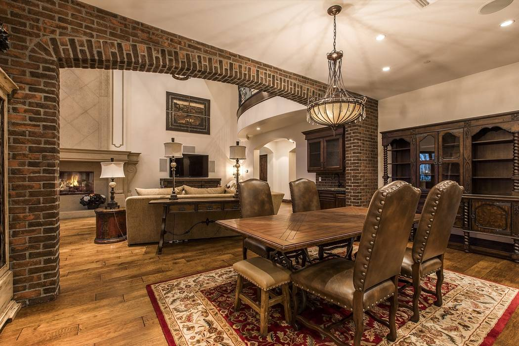 A an arched brick wall frames the dining area. (Team Carver, Berkshire Hathaway Home Services)