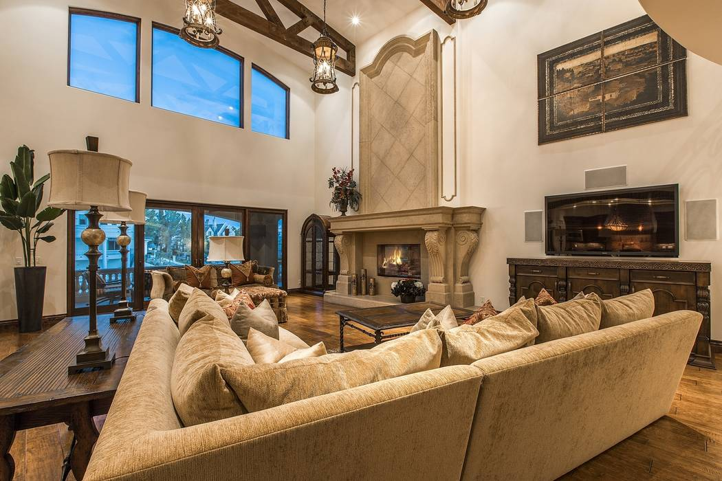 A gas fireplace is a centerpiece of the living room. (Team Carver, Berkshire Hathaway Home Services)