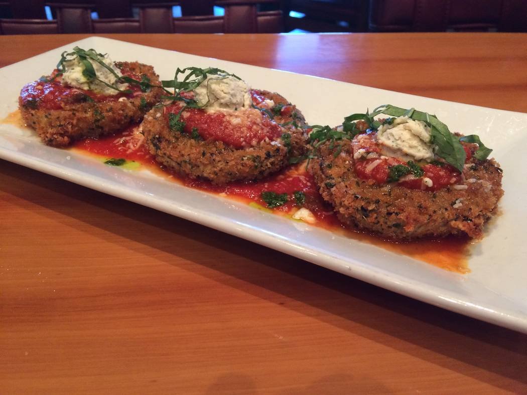 Eggplant pizzettes are a thinly sliced eggplant dredged in panko and lightly fried, dressed with a drizzle of marinara sauce and topped with cheese. (Jan Hogan/View)