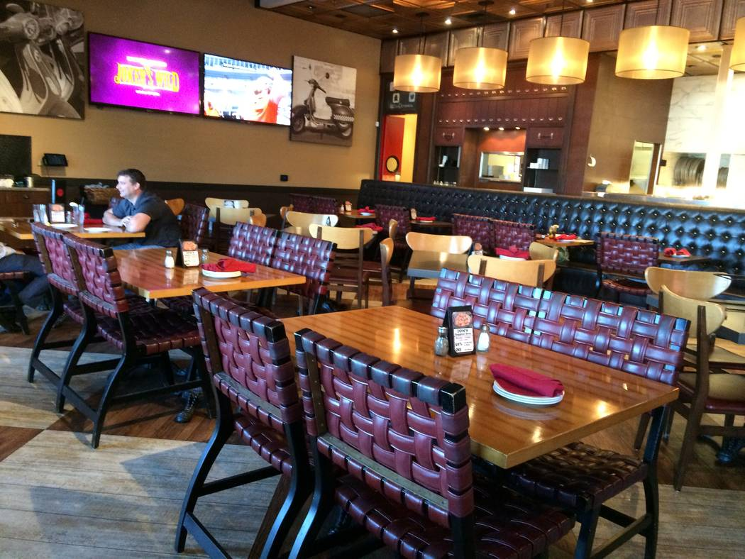 The interior of Dom DeMarco's is seen Oct. 16, 2017. It features dark woods against warm hues, the requisite red linen napkins, the mark of any authentic Italian eatery, and repeated beams on the  ...
