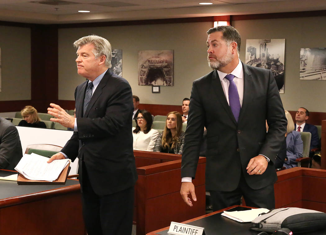 Attorney Brad Brian, left, representing MGM Resorts International, and Brian Nettles, attorney for Rachel Sheppard, who was shot three times during the October mass shooting, appear before a judge ...