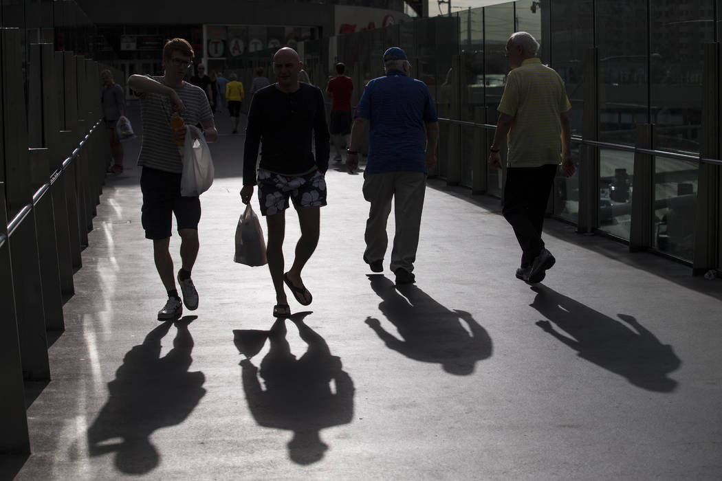 People walk over a pedestrian bridge linking Planet Hollywood Resort and The Cosmopolitan of Las Vegas on Thursday, Oct. 19, 2017. Richard Brian Las Vegas Review-Journal @vegasphotograph