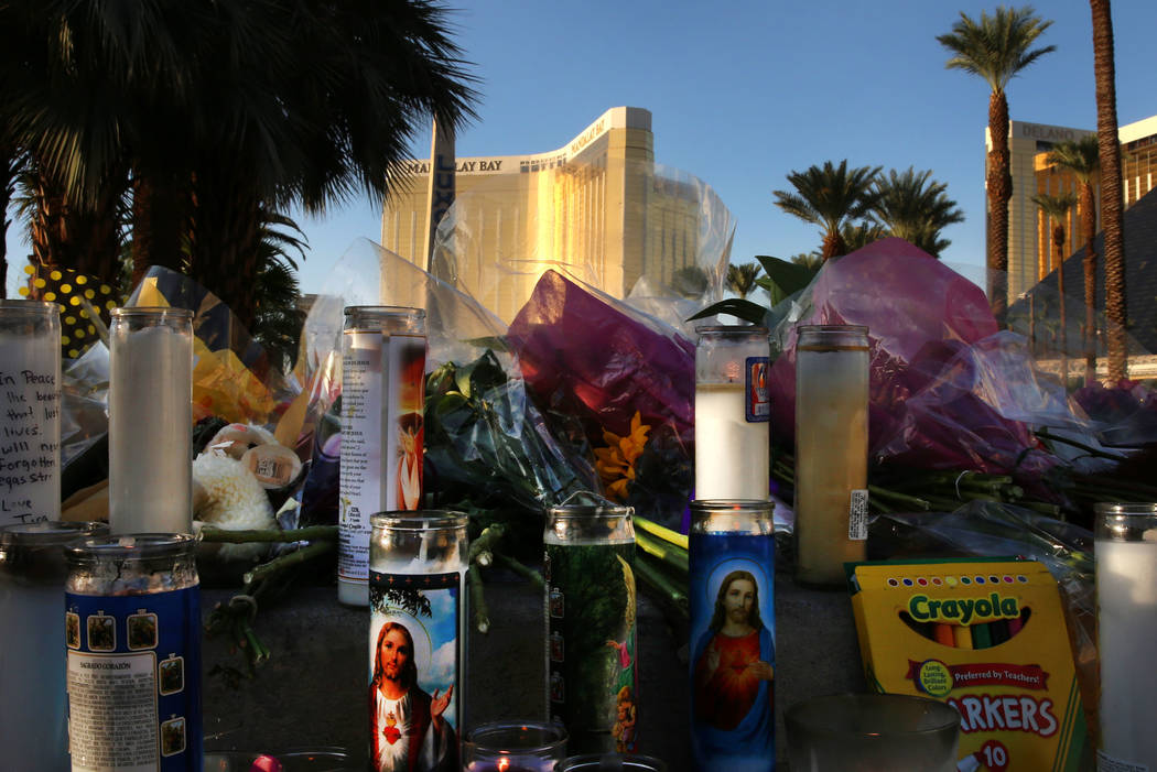 Flowers and candles are placed at a makeshift memorial for victims of the Route 91 Harvest mass shooting on Wednesday, Oct. 4, 2017 on Las Vegas Boulevard near Mandalay Bay in Las Vegas. Bizuayehu ...
