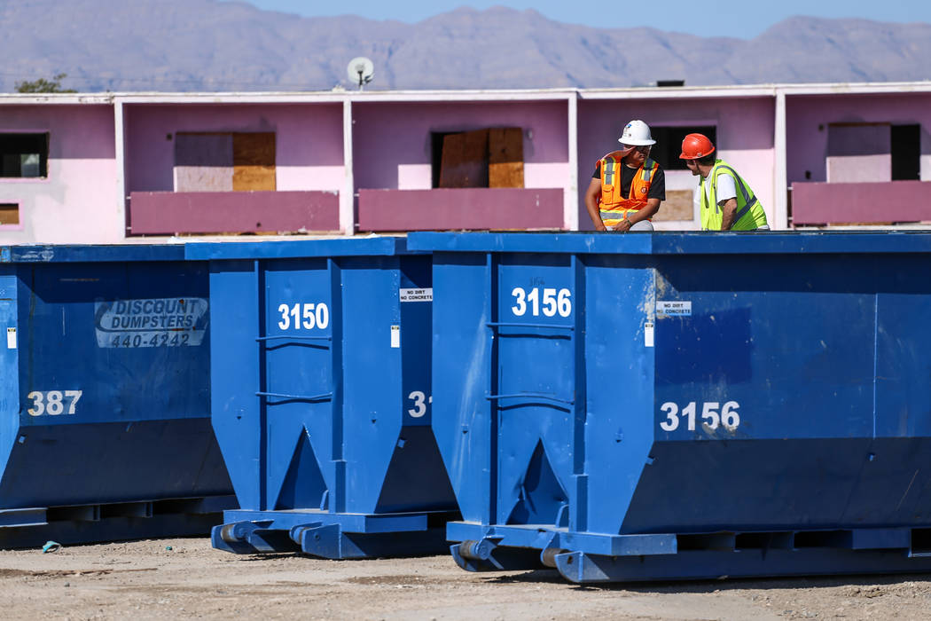 Workers sit on dumpsters as crews clean up remnants of the demolished Moulin Rouge in Las Vegas, Thursday, Oct. 19, 2017. Joel Angel Juarez Las Vegas Review-Journal @jajuarezphoto