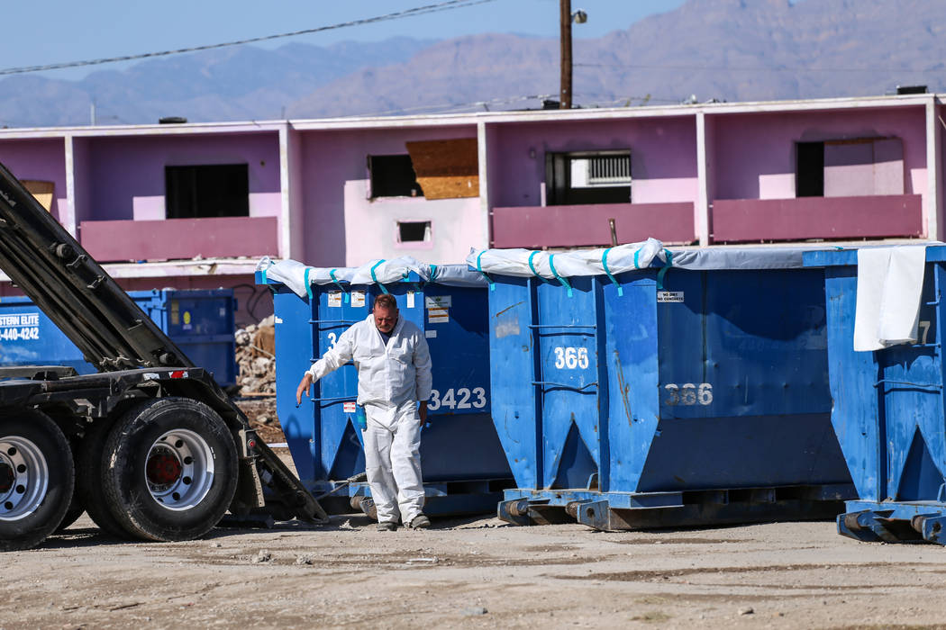 A worker walks away after aligning a truck with a dumpster as crews clean up remnants of the demolished Moulin Rouge in Las Vegas, Thursday, Oct. 19, 2017. Joel Angel Juarez Las Vegas Review-Journ ...