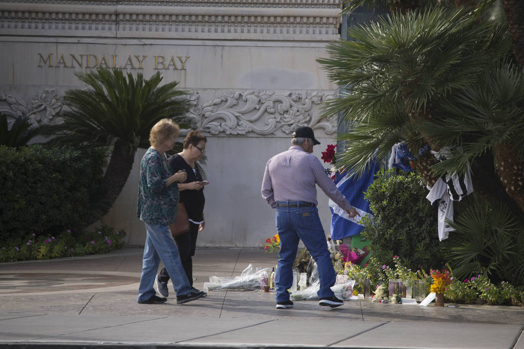 People visit a memorial for victims of the Route 91 Harvest shooting outside Mandalay Bay on Thursday, Oct. 19, 2017. Richard Brian Las Vegas Review-Journal @vegasphotograph