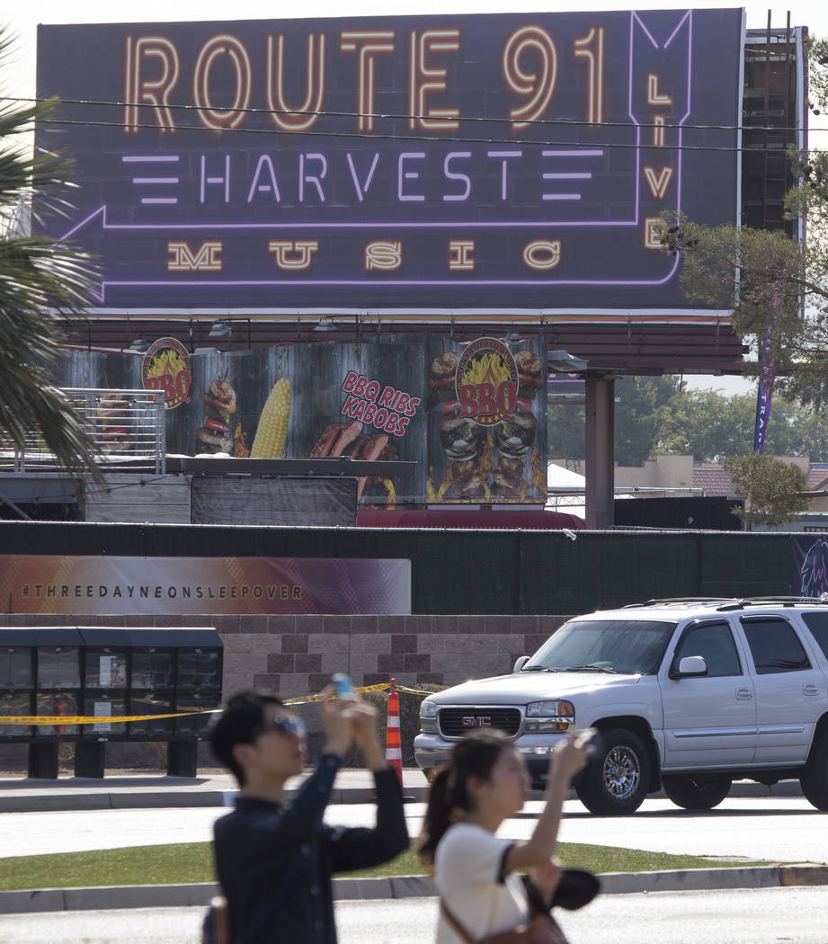 People walk past the site of the Route 91 Harvest country music festival at the Las Vegas Village festival grounds, Thursday, Oct. 19, 2017. Richard Brian Las Vegas Review-Journal @vegasphotograph