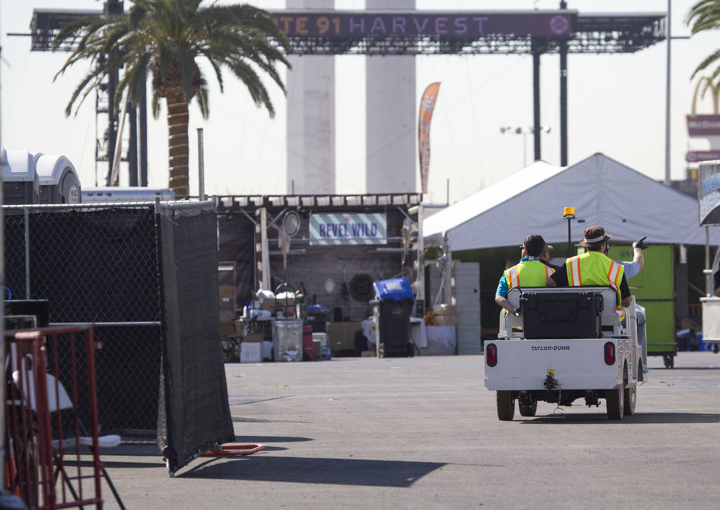 Workers enter the site of the Route 91 Harvest country music festival at the Las Vegas Village festival grounds, Thursday, Oct. 19, 2017. Richard Brian Las Vegas Review-Journal @vegasphotograph