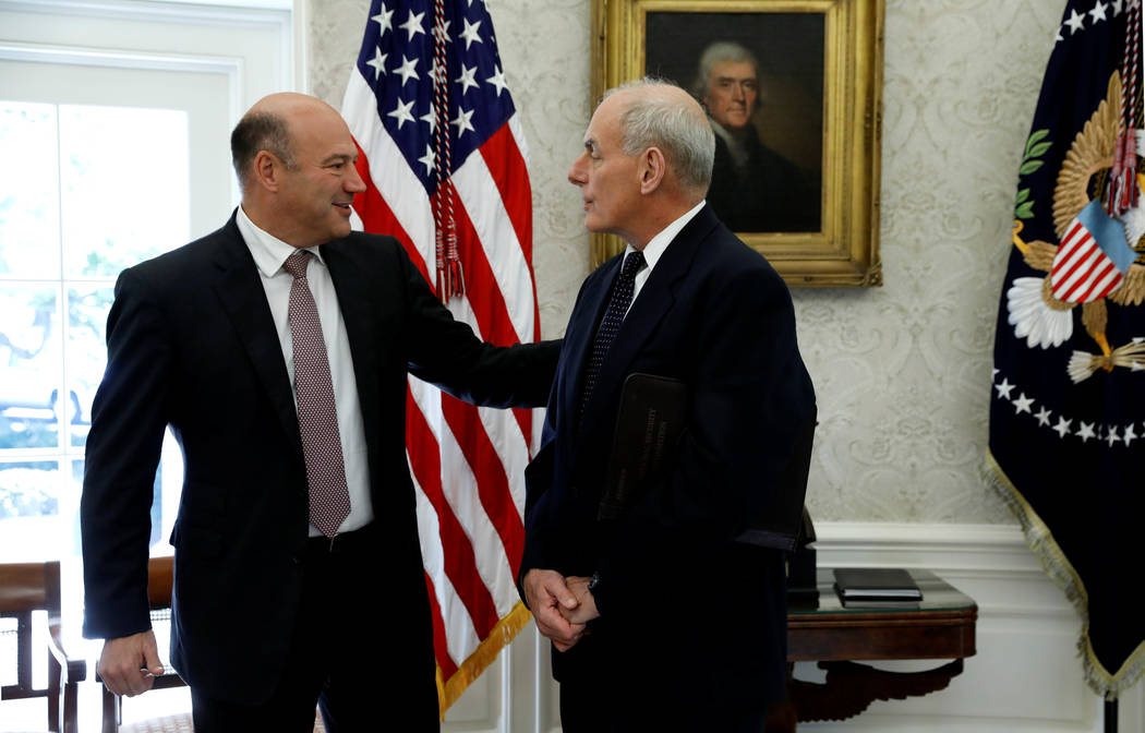 National Economic Council director Gary Cohn (L) and White House Chief of Staff John Kelly speak during a meeting between U.S. President Donald Trump and Puerto Rico Governor Ricardo Rossello in t ...