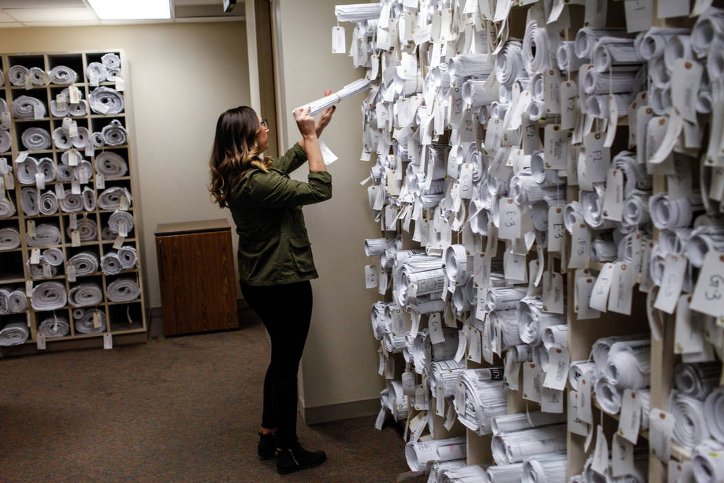 Randi Wald, 31, an archives and records technician II, searches through public records at the Development Services Records Center at City Hall in Henderson, Tuesday, Oct. 24, 2017. Joel Angel Juar ...