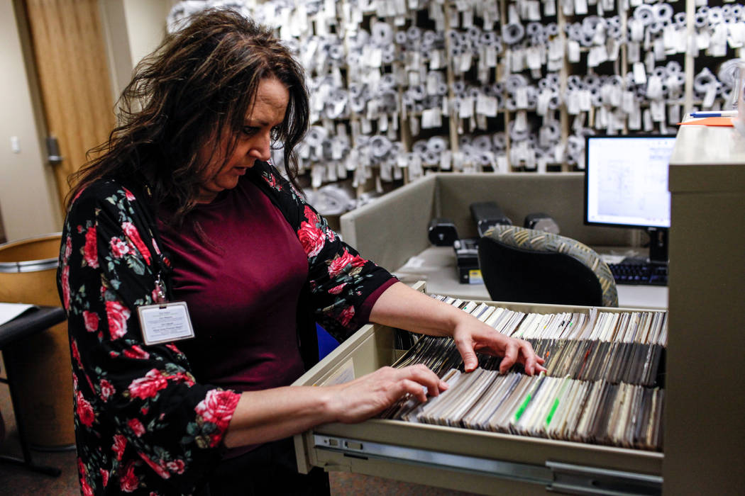 Diane Cottrell, an archives and records technician II, searches through films for a public records request at the Development Services Records Center at City Hall in Henderson, Tuesday, Oct. 24, 2 ...
