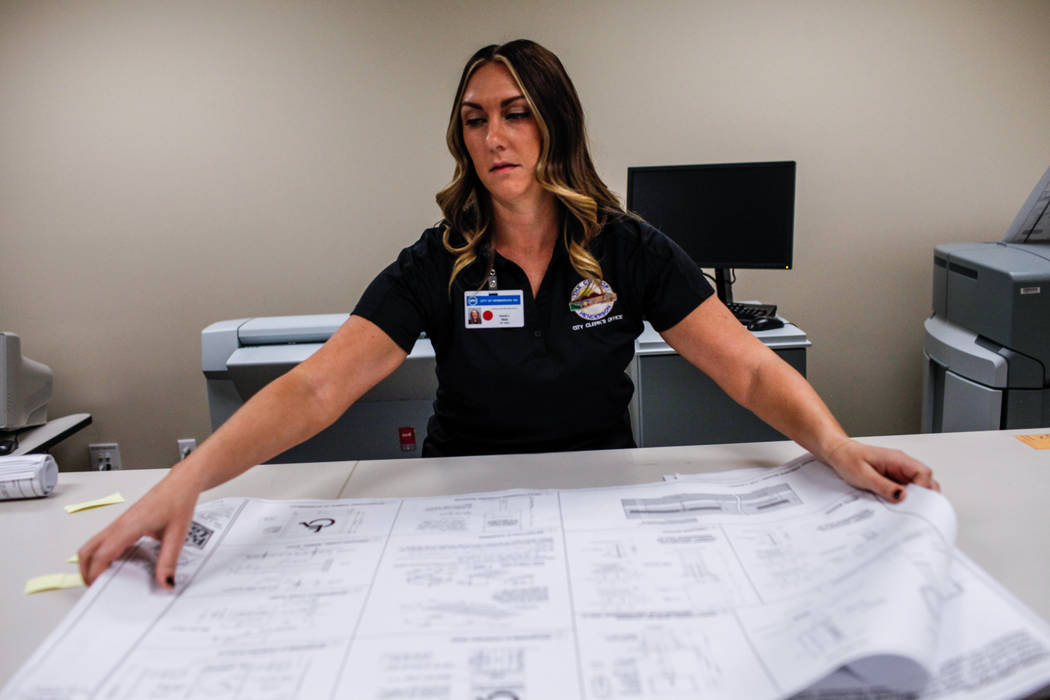 Randi Wald, 31, an archives and records technician II, lays out public records before making copies at the Development Services Records Center at City Hall in Henderson, Tuesday, Oct. 24, 2017. Jo ...