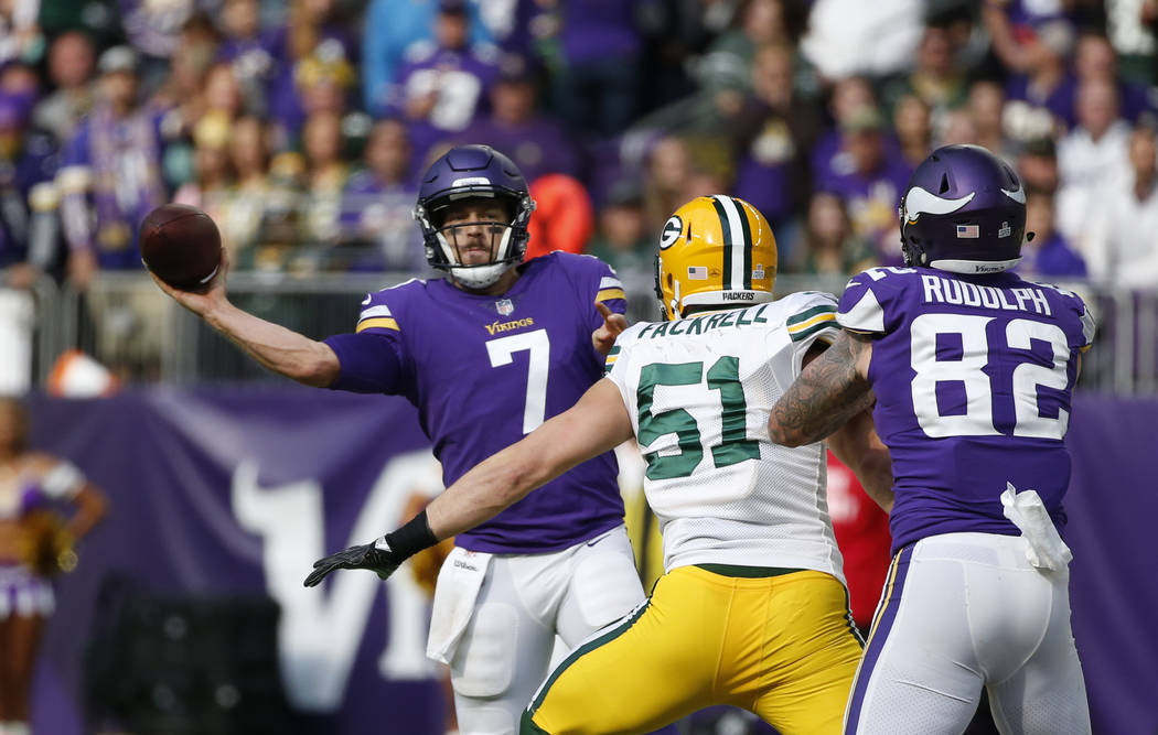 Minnesota Vikings quarterback Case Keenum (7) throws as Green Bay Packers outside linebacker Kyler Fackrell (51) applies pressure in the second half of an NFL football game in Minneapolis, Sunday, ...