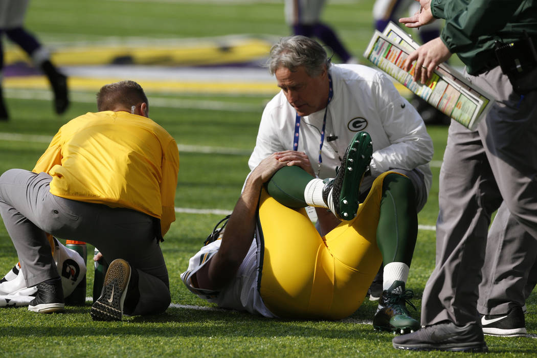 Green Bay Packers quarterback Aaron Rodgers (12) lies injured on the field against the Minnesota Vikings in the first half of an NFL football game in Minneapolis, Sunday, Oct. 15, 2017. (AP Photo/ ...