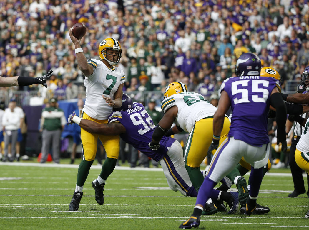 Green Bay Packers quarterback Brett Hundley (7) throws as Minnesota Vikings defensive tackle Tom Johnson (92) applies pressure in the first half of an NFL football game in Minneapolis, Sunday, Oct ...