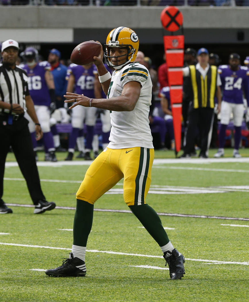 Green Bay Packers quarterback Brett Hundley (7) looks to throw against the Minnesota Vikings in the first half of an NFL football game in Minneapolis, Sunday, Oct. 15, 2017. (AP Photo/Jim Mone)