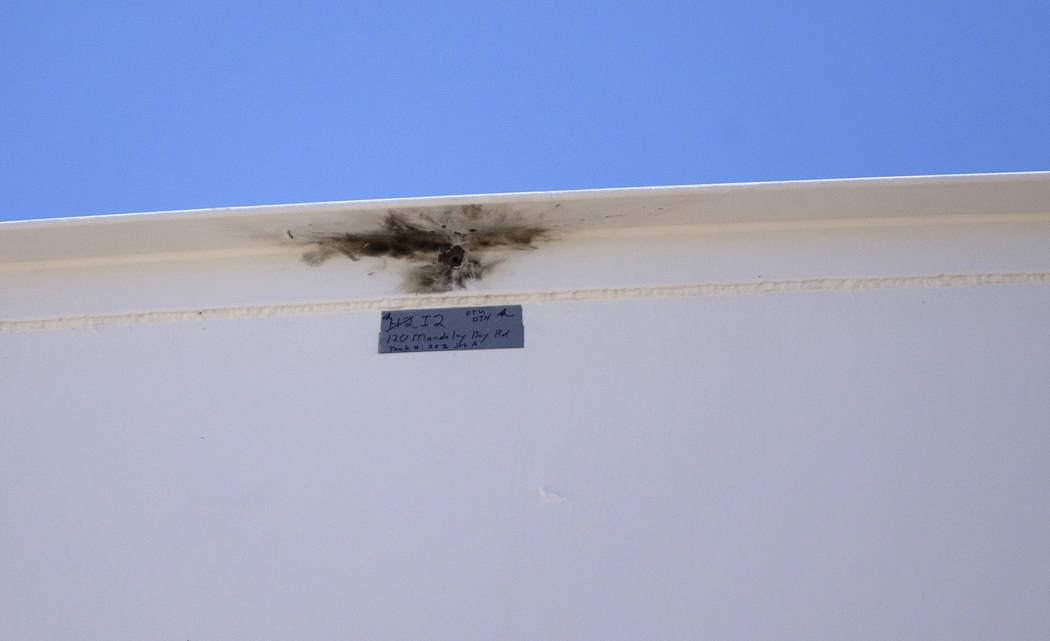 A bullet hole marked as evidence on a fuel tank near the site of the Route 91 Harvest country music festival in Las Vegas on Thursday, Oct. 19, 2017. The tank was struck by gunfire, October 1, 201 ...