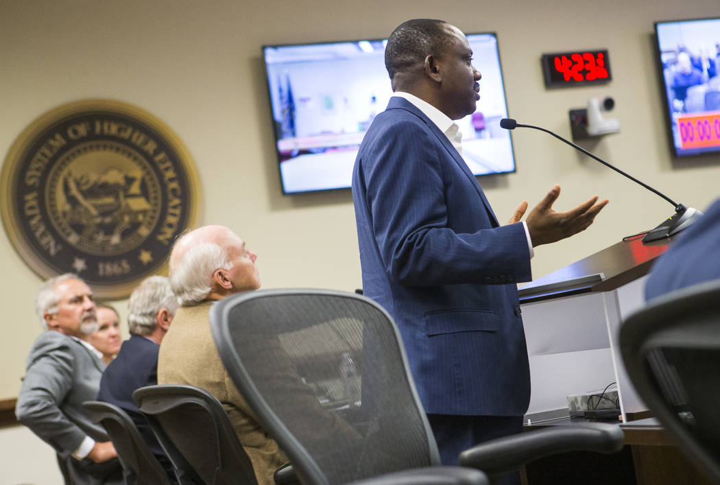 Professor Echezona Ezeanolue, who directs the pediatric HIV program at UNLV's School of Community Health Sciences, speaks during public comment at a meeting of the Nevada Board of Regents at the N ...