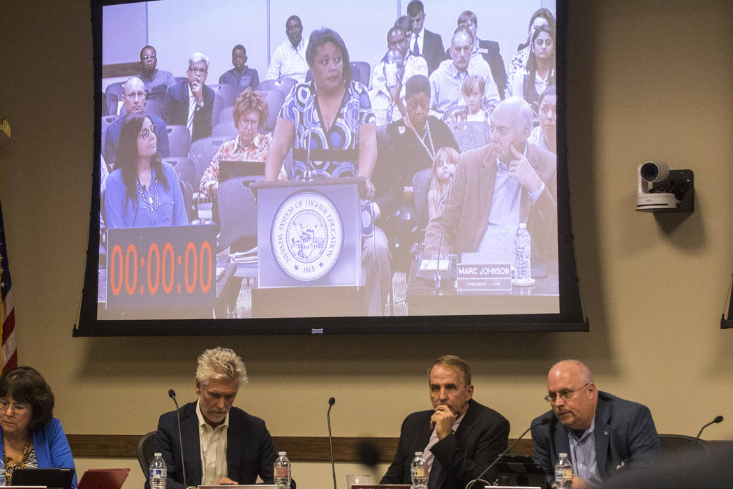 Simona Johnson, mother of a daughter with HIV, shown on the screen, speaks during public comment at a meeting of the Nevada Board of Regents at the Nevada System of Higher Education administration ...