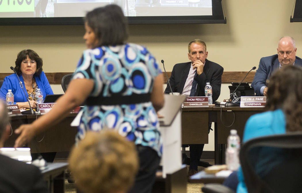 Simona Johnson, mother of a daughter with HIV, second from left, speaks during public comment at a meeting of the Nevada Board of Regents at the Nevada System of Higher Education administration of ...