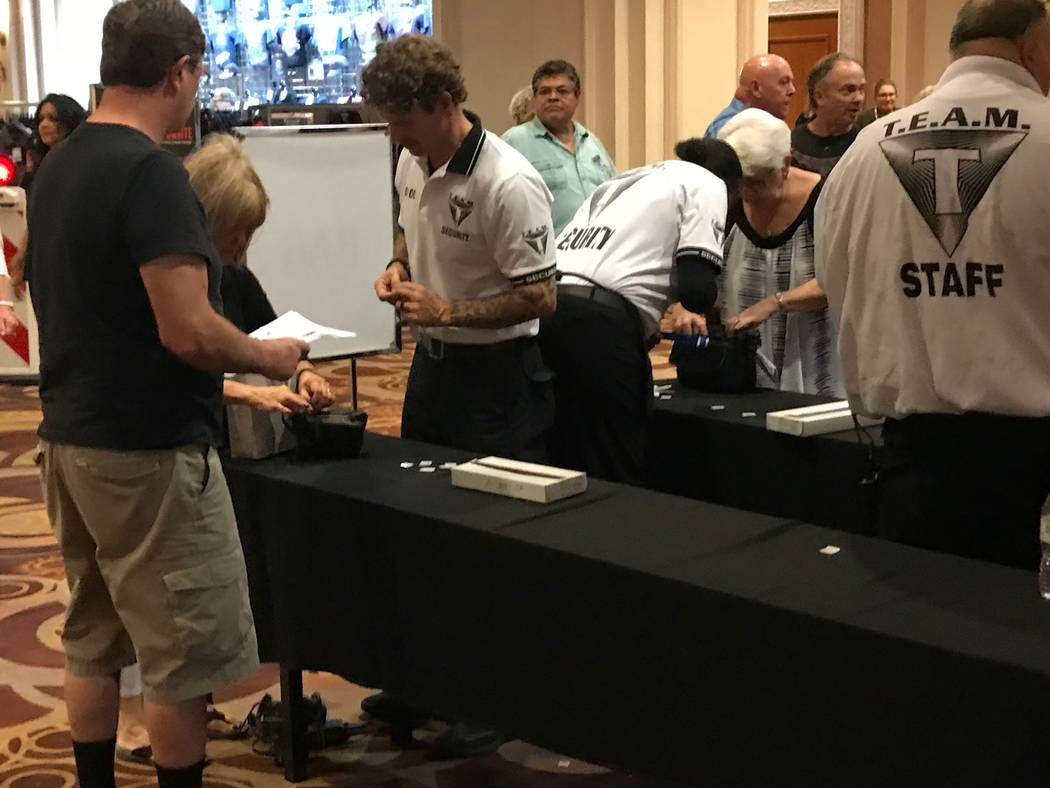Security staff are now checking people entering the Barrett Jackson car auction with hand-held metal detectors and performing bag checks. (Todd Prince/Las Vegas Review-Journal)