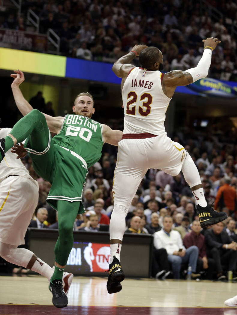 Boston Celtics' Gordon Hayward (20) falls as Cleveland Cavaliers' LeBron James (23) reaches for a loose ball in the first half of an NBA basketball game, Tuesday, Oct. 17, 2017, in Cleveland. Hayw ...