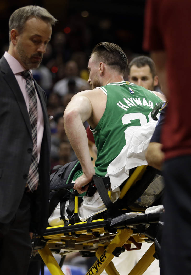 Boston Celtics' Gordon Hayward is carried away in a stretcher in the first half of an NBA basketball game against the Cleveland Cavaliers, Tuesday, Oct. 17, 2017, in Cleveland. Just five minutes i ...