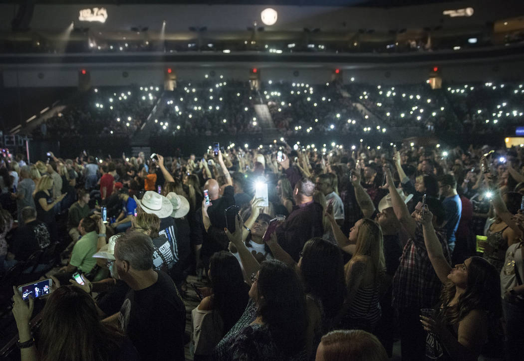 """The crowd cheers for Big & Rich during """"Vegas Strong: A Night of Healing,"""" a benefit concert on Thursday, October 19, 2017, at The Orleans Arena, in Las Vegas, for first responders and those a ..."""