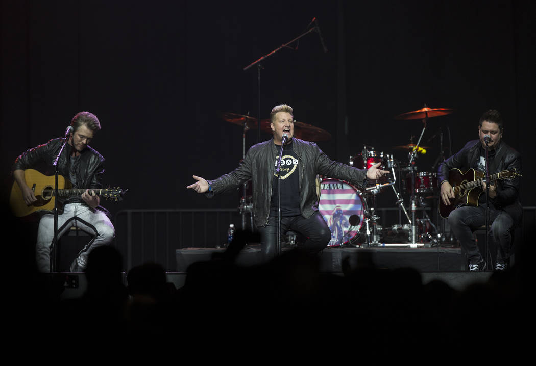"""Rascal Flatts perform a surprise set during """"Vegas Strong: A Night of Healing,"""" a benefit concert on Thursday, October 19, 2017, at The Orleans Arena, in Las Vegas, for first responders and those  ..."""